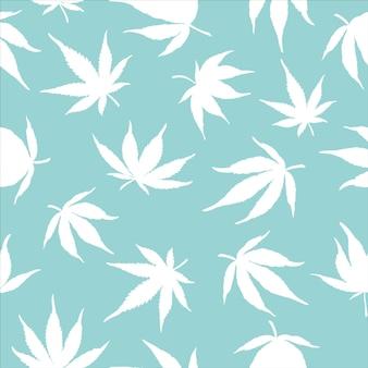 Naadloos patroon van witte cannabisbladeren op een blauwe achtergrond