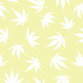 Naadloos patroon van witte cannabisbladeren op een gele achtergrond