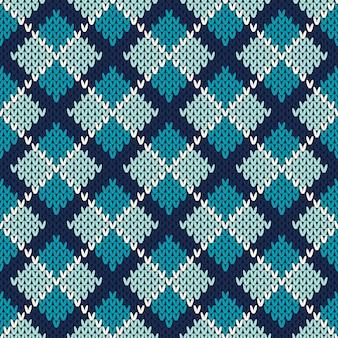 Naadloos patroonornament op de wol gebreide textuur Premium Vector