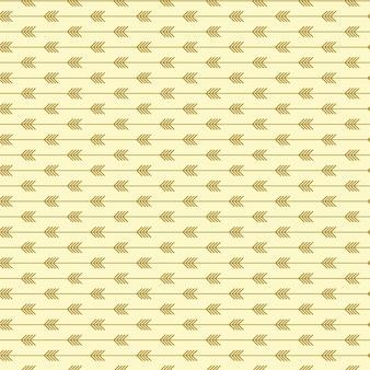 Naadloos pijlpatroon met lichte gouden kleuren
