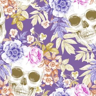 Naadloos vintage patroon met bloemen en schedels