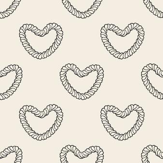 Naadloos zwart-wit hart van een achtergrond van het kabelpatroon