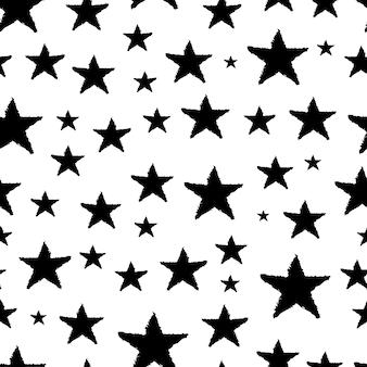 Naadloze achtergrond van doodle sterren. zwarte hand getrokken sterren op witte achtergrond. vector illustratie