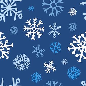 Naadloze achtergrond van hand getrokken sneeuwvlokken. kerstmis en nieuwjaar decoratie-elementen. vector illustratie.