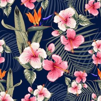 Naadloze bloemenpatroon hibiscus bloemen donkerblauwe achtergrond.