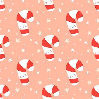 Naadloze kerst achtergrond met schattige snoep riet. vectorillustratie in platte cartoonstijl op een roze achtergrond. ideaal voor stof en inpakpapier.
