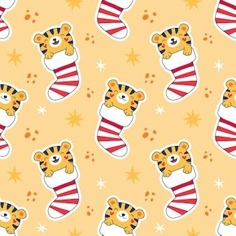 Naadloze patroon cartoon feestelijke tijgerwelpen in kerst sokken