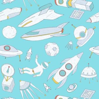 Naadloze patroon met cartoon ruimtevoorwerpen hand getekend op blauw