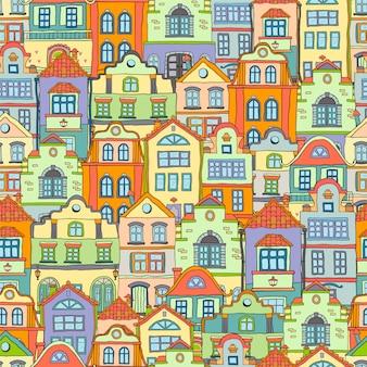 Naadloze patroon met doodles gekleurde scandinavische huizen. gekleurde achtergrond.