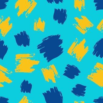 Naadloze patroon met gele en blauwe hand getrokken krabbel uitstrijkje op blauwe achtergrond. abstracte grungetextuur. vector illustratie