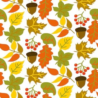 Naadloze patroon met heldere bladeren eikels en bessen op een witte achtergrond in een vlakke stijl autum