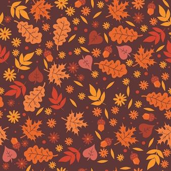 Naadloze patroon met herfstbladeren en bloemen