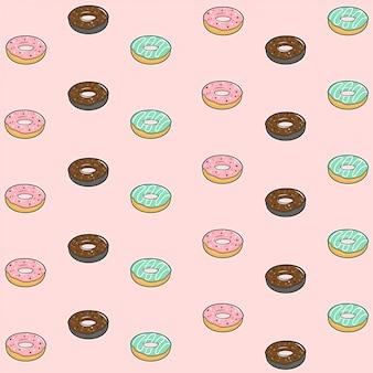 Naadloze patroon met kleurrijke donuts met glazuur en hagelslag op pastel roze