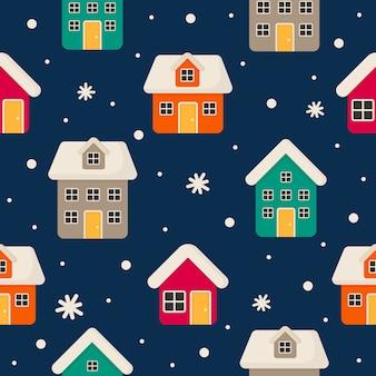 Naadloze patroon met kleurrijke huizen geïsoleerd op blauwe achtergrond.