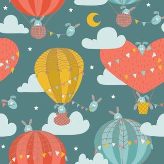 Naadloze patroon met schattig konijntje in hete luchtballon kinderachtig dier op de fantastische sterrenhemel met ...