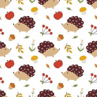 Naadloze patroon met schattige egel, bladeren en paddestoelen. herfstachtergrond voor het naaien van kinderkleding, bedrukken op stof en textiel.