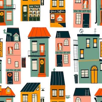 Naadloze patroon met schattige gezellige huizen, handgetekende. plat ontwerp. handgetekende trendy illustraties. gekleurde vectorillustratie. alle elementen zijn geïsoleerd