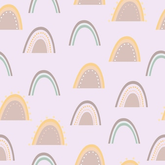 Naadloze patroon van regenbogen op paars