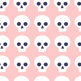Naadloze patroon van schattige cartoon schedels op een roze achtergrond. attributen voor magie en hekserij. hand getekend