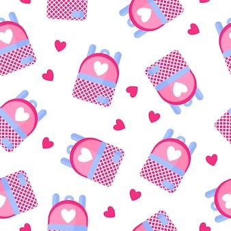 Naadloze patroon van schoolrugzak met hart