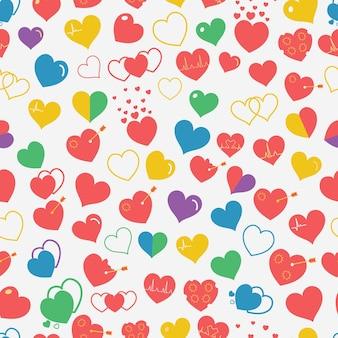 Naadloze patroon van verschillende eenvoudige veelkleurige harten op witte achtergrond. plat ontwerp