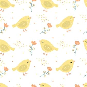 Naadloze patroon vrolijk pasen met gele kip en bloemen