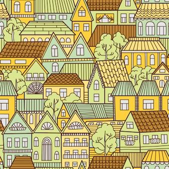 Naadloze patroonachtergrond met huizen en bomen