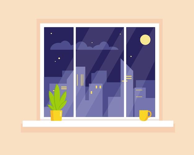 Nacht uitzicht op de stad door het raam