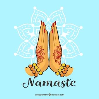 Namaste gebaar met henna tattoos