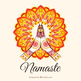 Namaste gebaar met kleurrijke mandala