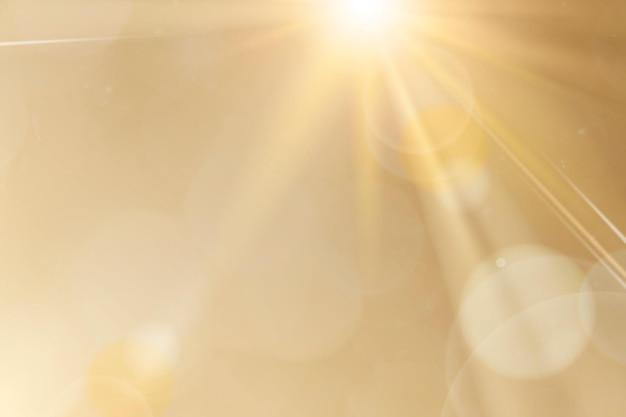 Natuurlijk licht lens flare vector op gouden achtergrond zonnestraal effect