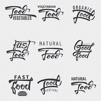 Natuurlijk voedsel, biologische voeding, voedselfestival, goed eten - insignes is gemaakt met behulp van belettering en kalligrafievaardigheden, gebruik de juiste typografie en compositie.