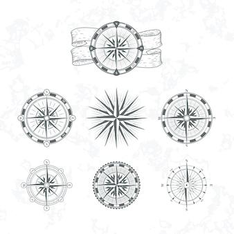 Nautisch kompas. mariene windroos voor kaarten. vintage stijl illustraties. set kompas nautisch voor kaartnavigatie