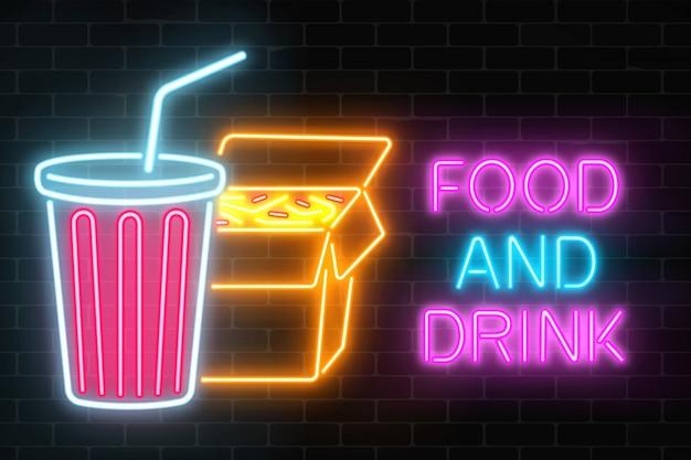 Neon eten en drinken gloeiend uithangbord op een donkere bakstenen muur