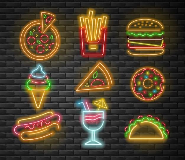 Neon fastfood set, grote set, pizza, frietjes, hamburger, ijs, donut, hotdog, cocktail en taco, neonlicht, bakstenen achtergrond