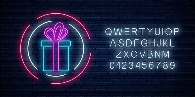 Neon geschenk met gloeiende lint teken in cirkelvormen met alfabet op een donkere bakstenen muur achtergrond