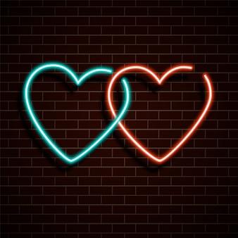 Neon hart. een fel rood en blauw bord.