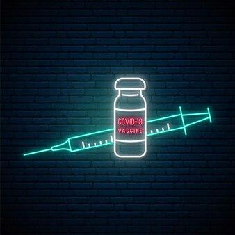 Neon uithangbord met vaccin tegen covid.