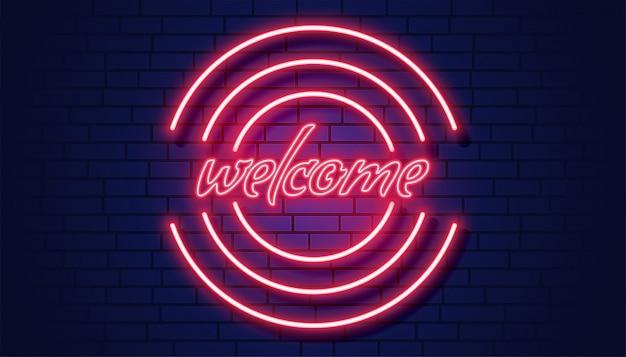Neon welkom uithangbord op bakstenen muurachtergrond