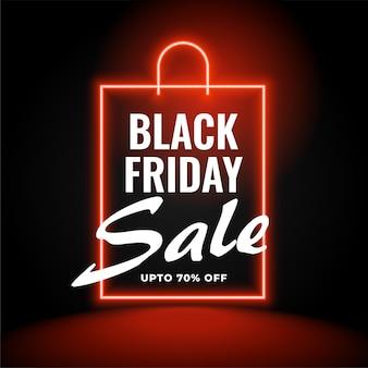 Neon zwarte vrijdag verkoop achtergrond met boodschappentas