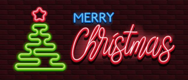 Neonsymbolen van vrolijke de kerstmis van de alfabetdoopvont bakstenen muur