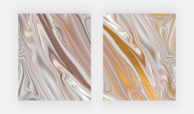 Neutrale vloeibare inkt met gouden folietextuur.