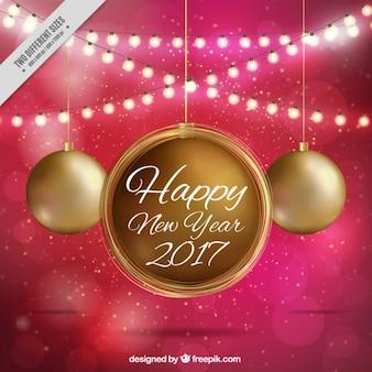 Nieuwe jaar achtergrond van gouden kerstballen en lichtslingers