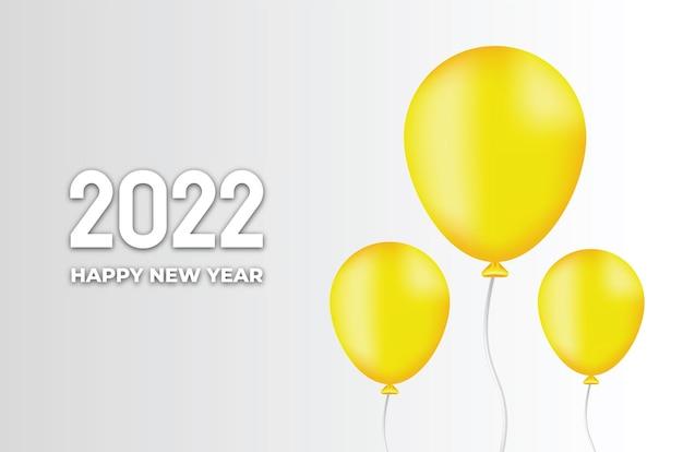 Nieuwjaar 2022 achtergrond met gele ballon