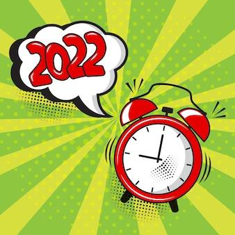 Nieuwjaar 2022 vector komische wekker met tekstballon op groene achtergrond. komisch geluidseffect, sterren en halftoonpunten schaduw in pop-art stijl. vakantie