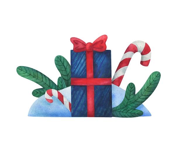 Nieuwjaarsgeschenk. kerstmissamenstelling met dennentakken, decoratieve doos en suikergoed.