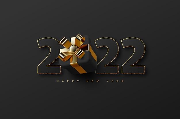 Nieuwjaarskaart 2022 met 3d-gouden en zwarte cijfers met geschenkdoos op zwart