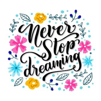 Nooit stoppen met dromen belettering met bloemen