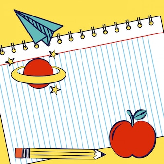 Notitieboekje met appel, planeet, potlood en schoolbenodigdheden