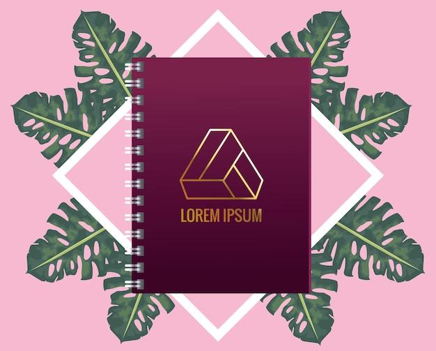 Notitieboekje met driehoeksembleem met bladerenillustratie